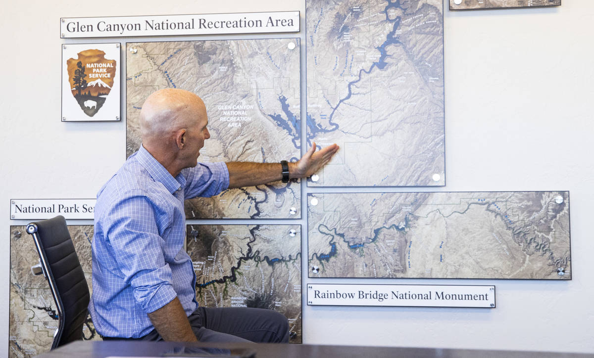 William Shott, superintendent of Glen Canyon National Recreation Area, points to a map while ta ...