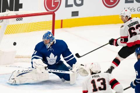 Ottawa Senators right winger Evgenii Dadonov(63) puts the puck past Toronto Maple Leafs goalten ...