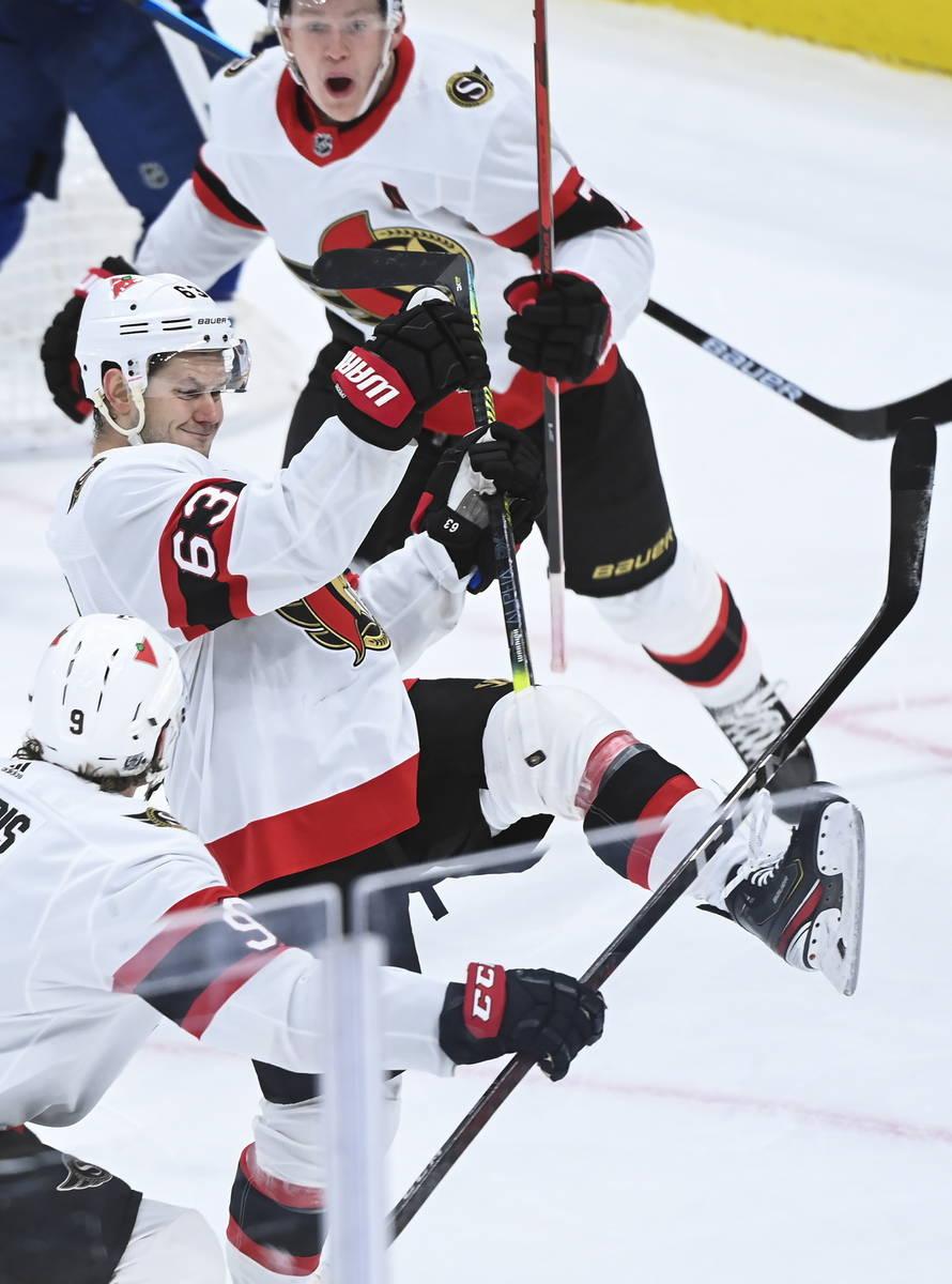 Ottawa Senators right wing Evgenii Dadonov (63) celebrates after he scored the winning goal aga ...