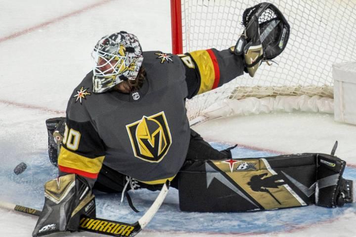 Minnesota Wild center Victor Rask (49) takes a shot of Golden Knights goaltender Robin Lehner ( ...