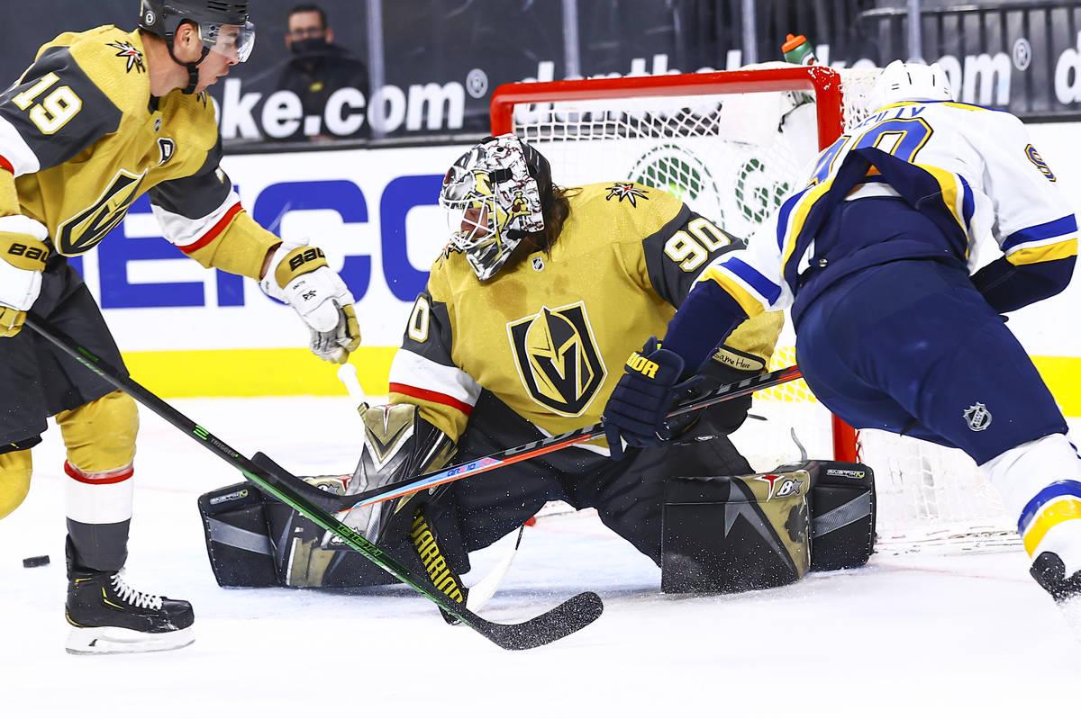 Golden Knights goaltender Robin Lehner (90) blocks a shot from St. Louis Blues' Ryan O'Reilly, ...