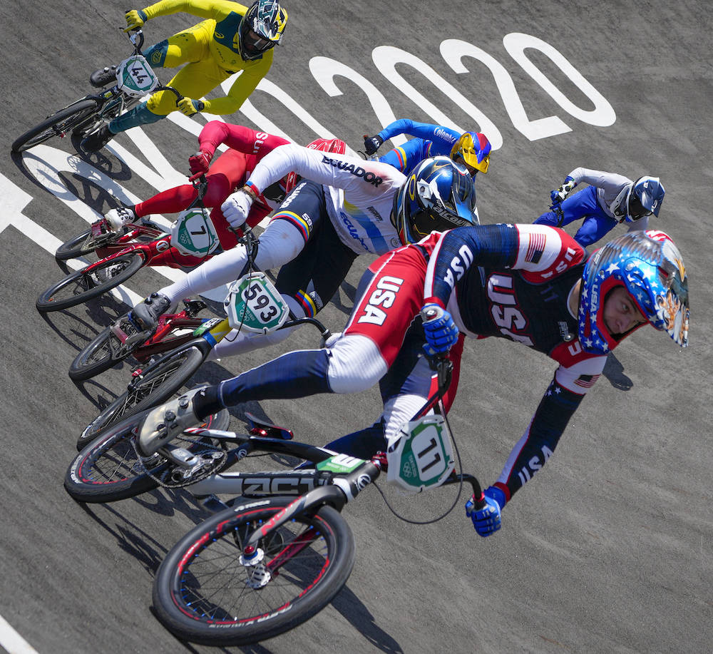 Connor Fields of the United States, center, leads the pack followed by Alfredo Campo of Ecuador ...