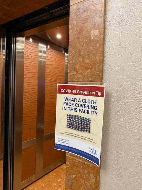 A sign asking people to wear masks inside the building is seen at the Regional Justice Center i ...