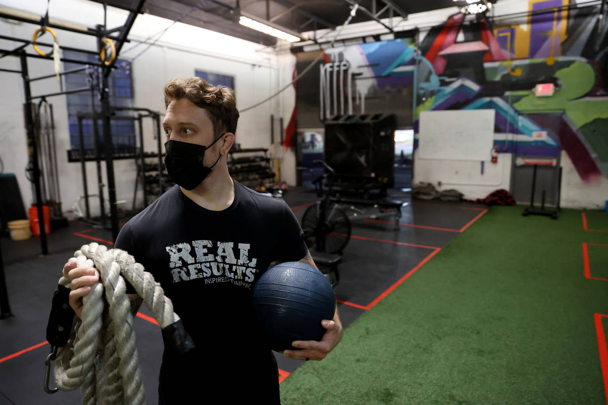 Lead coach Michael Hayden works with a client at Real Results Fitness gym in downtown Las Vegas ...