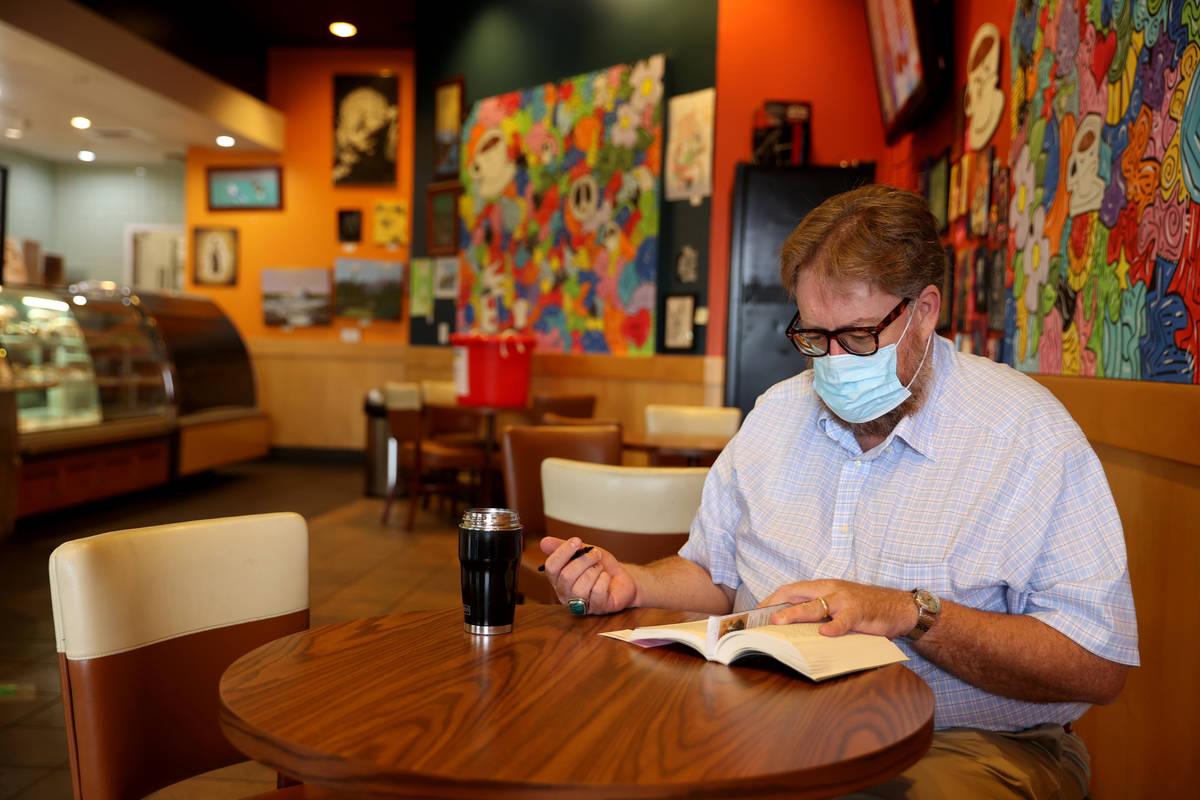 Howard Giles of Henderson reads at Grouchy John's Coffee on West Charleston Boulevard in Las Ve ...