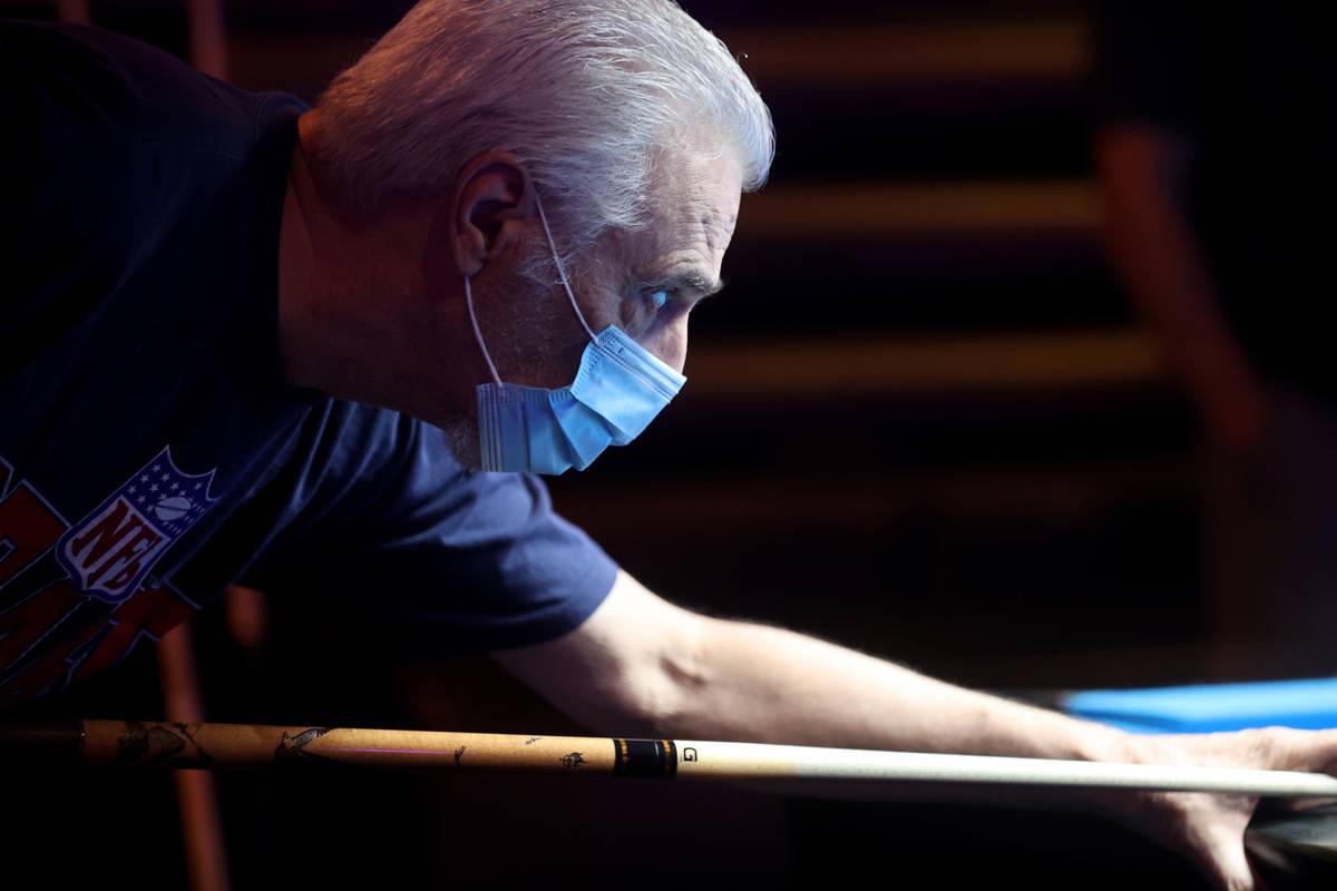 Ron Pniewski of Henderson plays pool at Griffs Bar & Billiards in Las Vegas on the first da ...