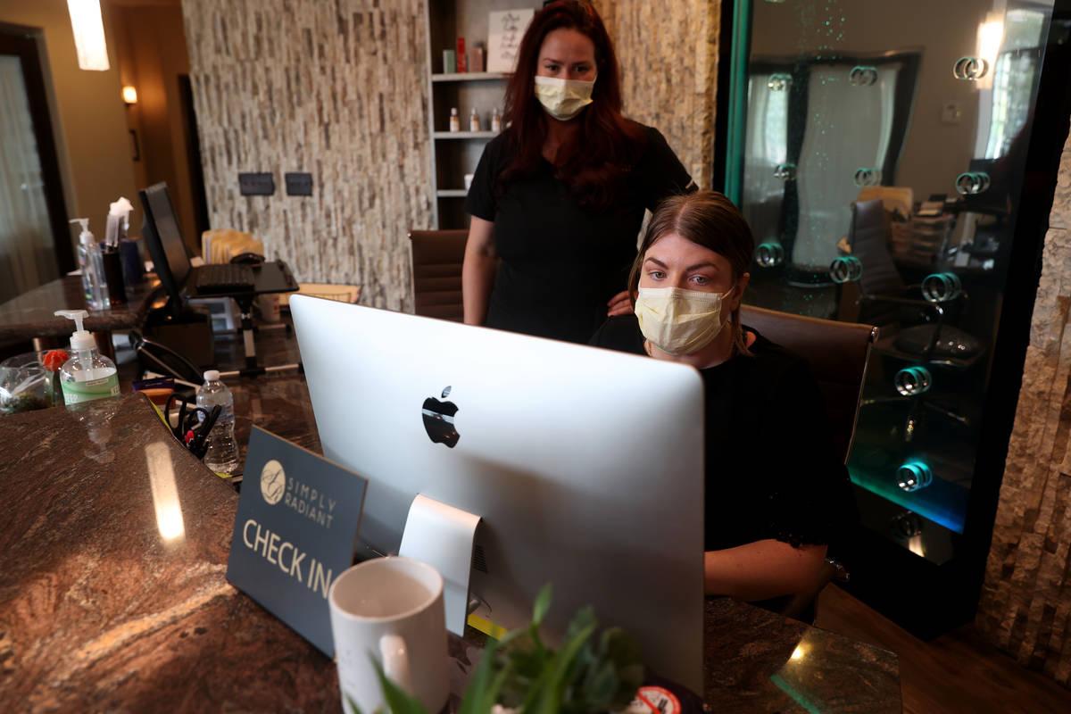 Receptionist Heather Rasmussen, right, and laser technician Jennifer Knepper work at Simply Rad ...