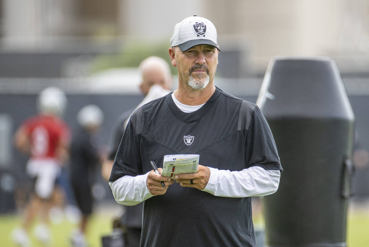 Raiders New Defensive Coordinator Gus Bradley observes his players during training camp at the ...
