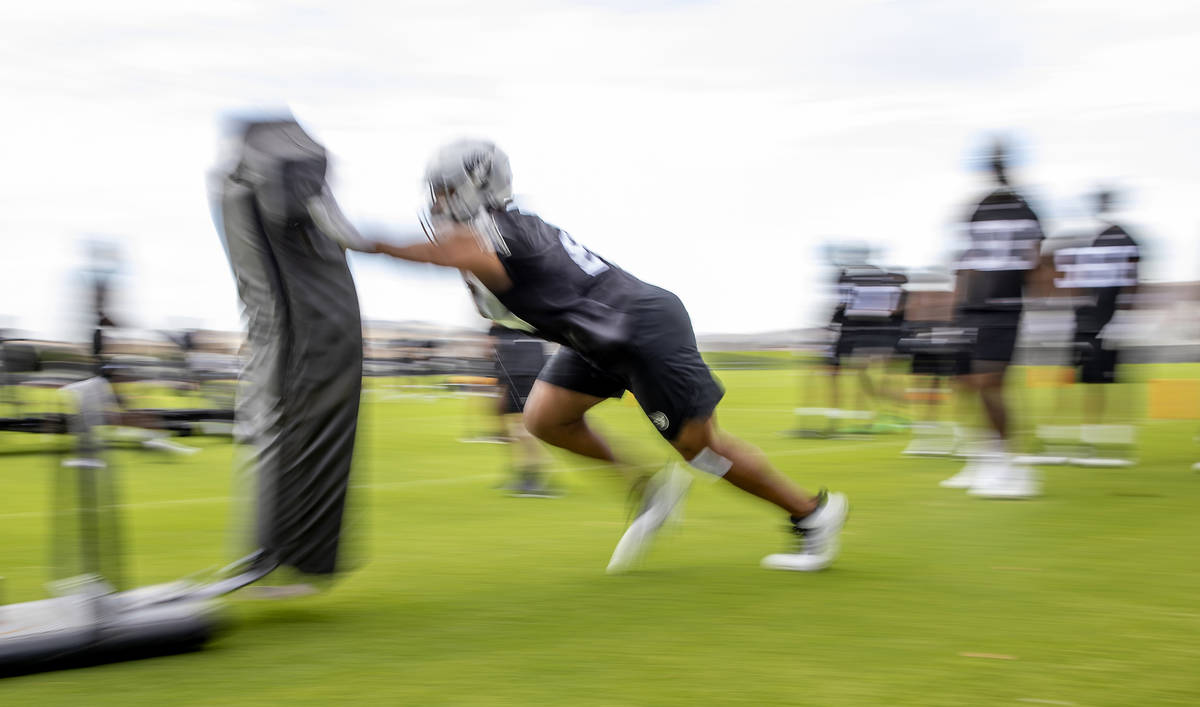 A Raiders defensive player hits a tackling sled during training camp at the Intermountain Healt ...