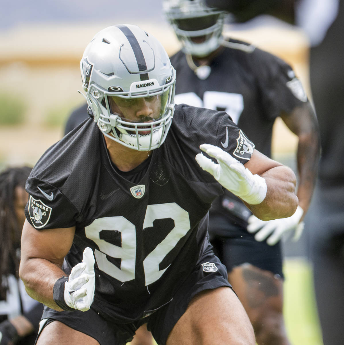 Raiders defensive end Solomon Thomas (92) gets low during a drill in training camp at the Inter ...