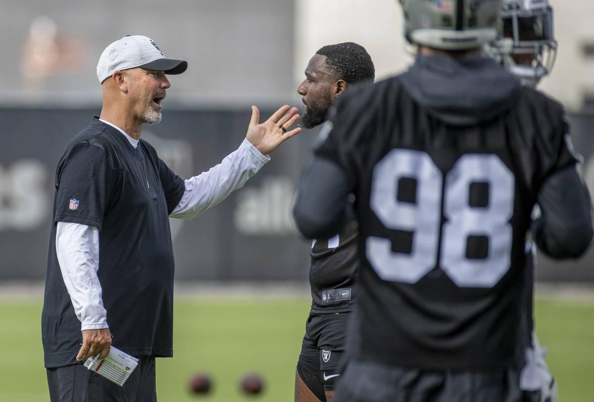 Raiders New Defensive Coordinator Gus Bradley speaks with Raiders defensive end Yannick Ngakoue ...