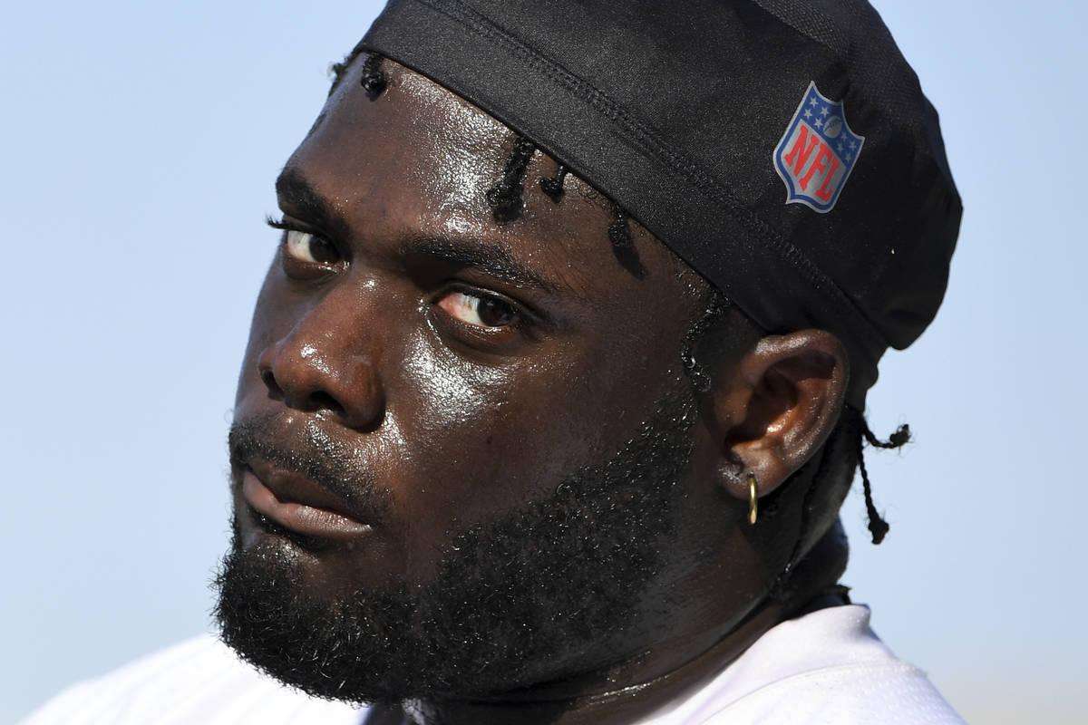 Las Vegas Raiders offensive tackle Alex Leatherwood looks on during an NFL football practice We ...