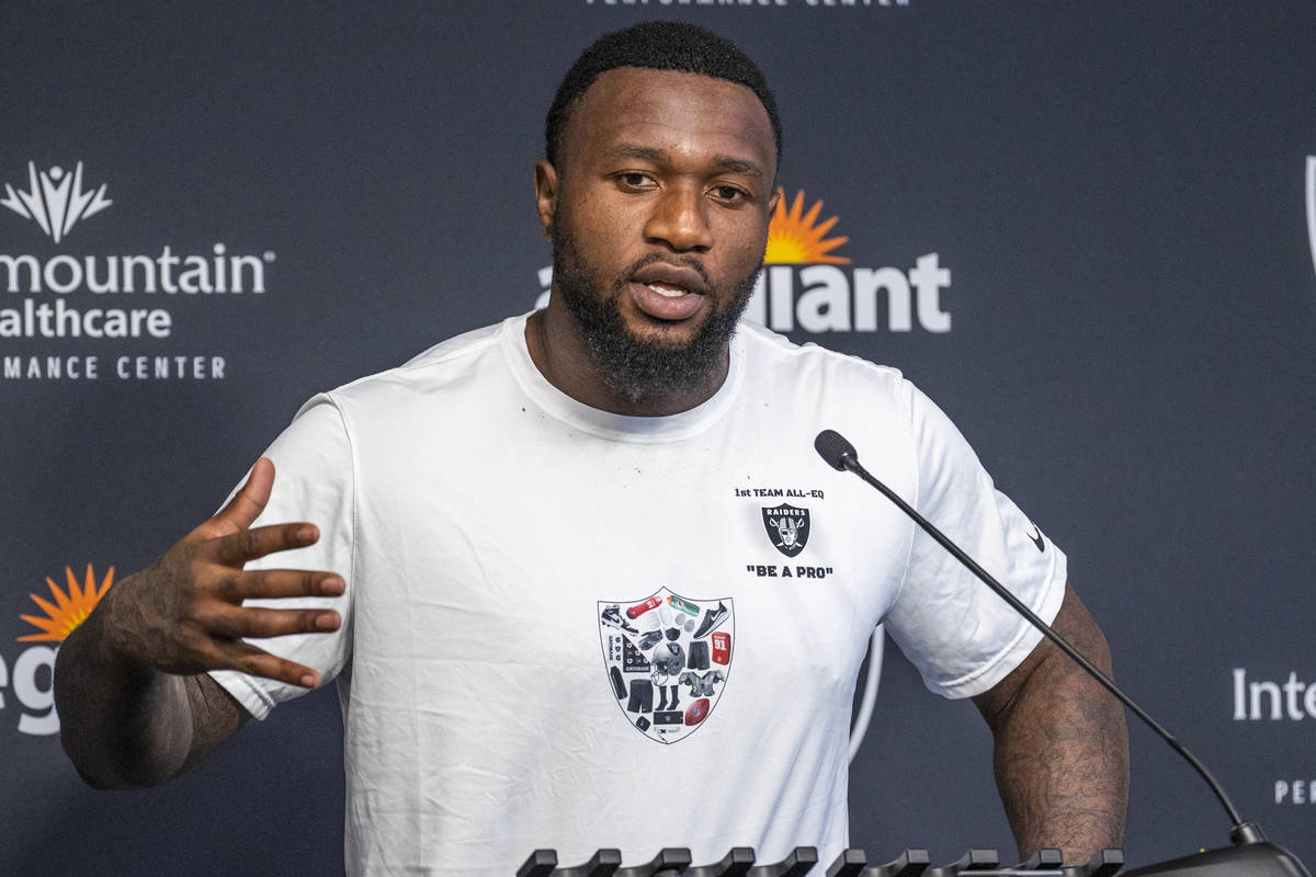 Raiders defensive end Yannick Ngakoue (91) answers a media question during training camp at the ...