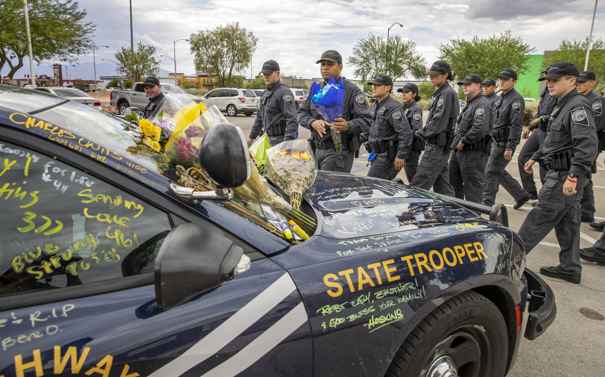 Nevada Highway Patrol cadets arrive to pay homage to Trooper Micah May with his car #203 parked ...