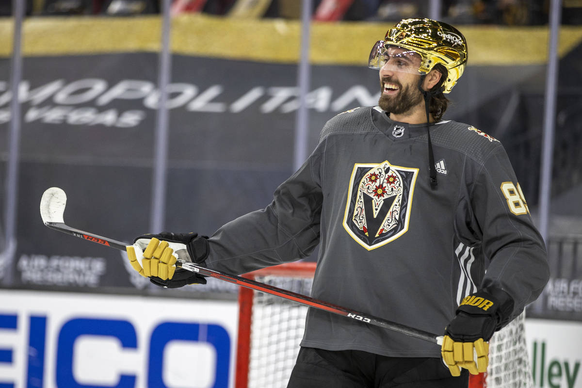 Golden Knights right wing Alex Tuch (89) laughs teammates during the warm-up period of an NHL g ...