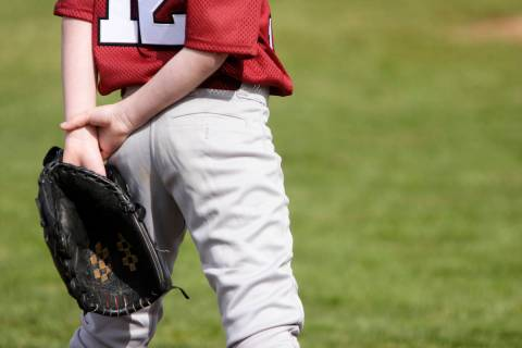 Young baseball player on the field. (Getty Images)