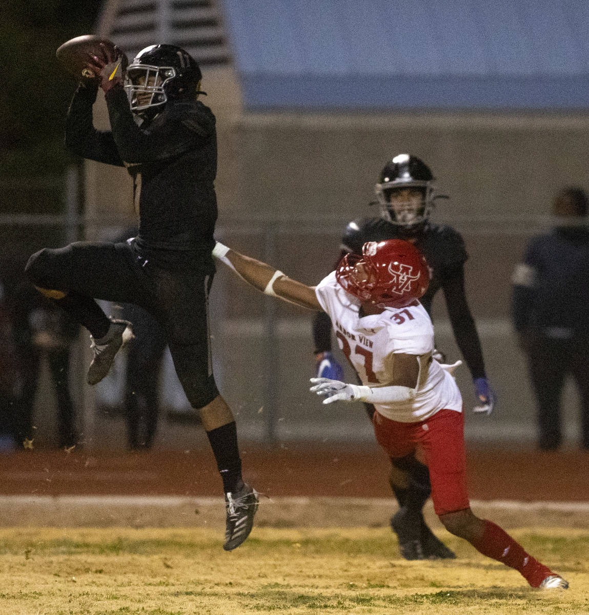 Desert Pines' Jet Solomon (11) catches the ball in the final second of the game as Arbor View's ...