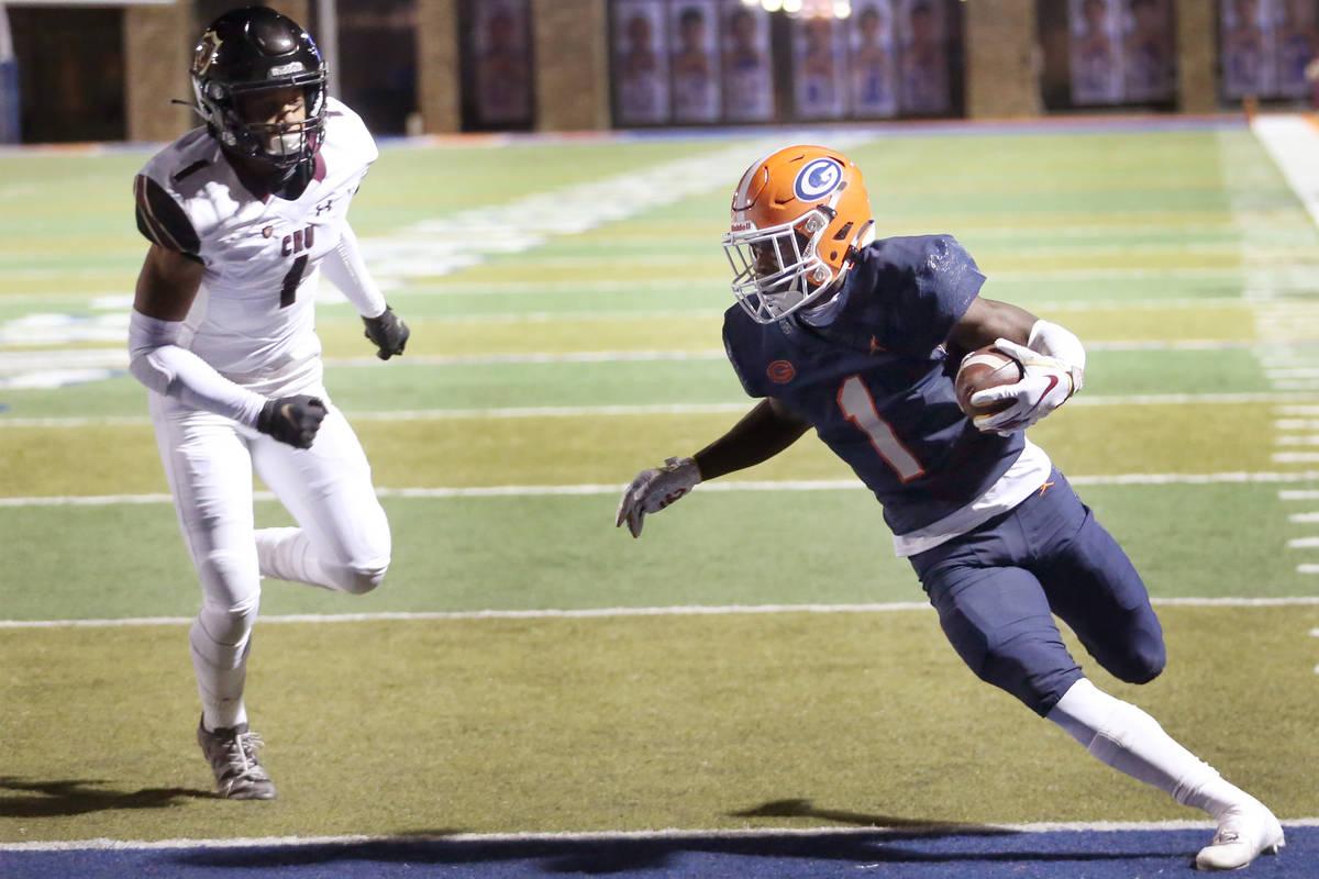 Bishop Gorman's Zachariah Branch (1) runs the ball for a touchdown as Faith Lutheran's Joshua G ...