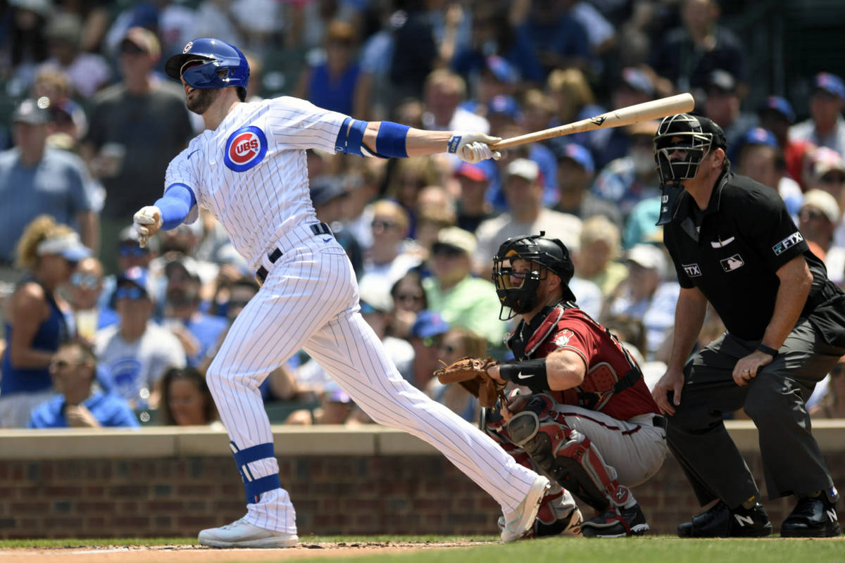 Chicago Cubs' Kris Bryant watches his two-run home run during the first inning of a baseball ga ...