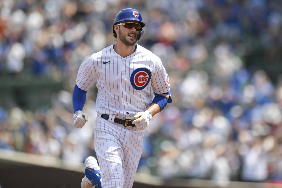 Chicago Cubs' Kris Bryant rounds the bases after hitting a two-run home run during the first in ...