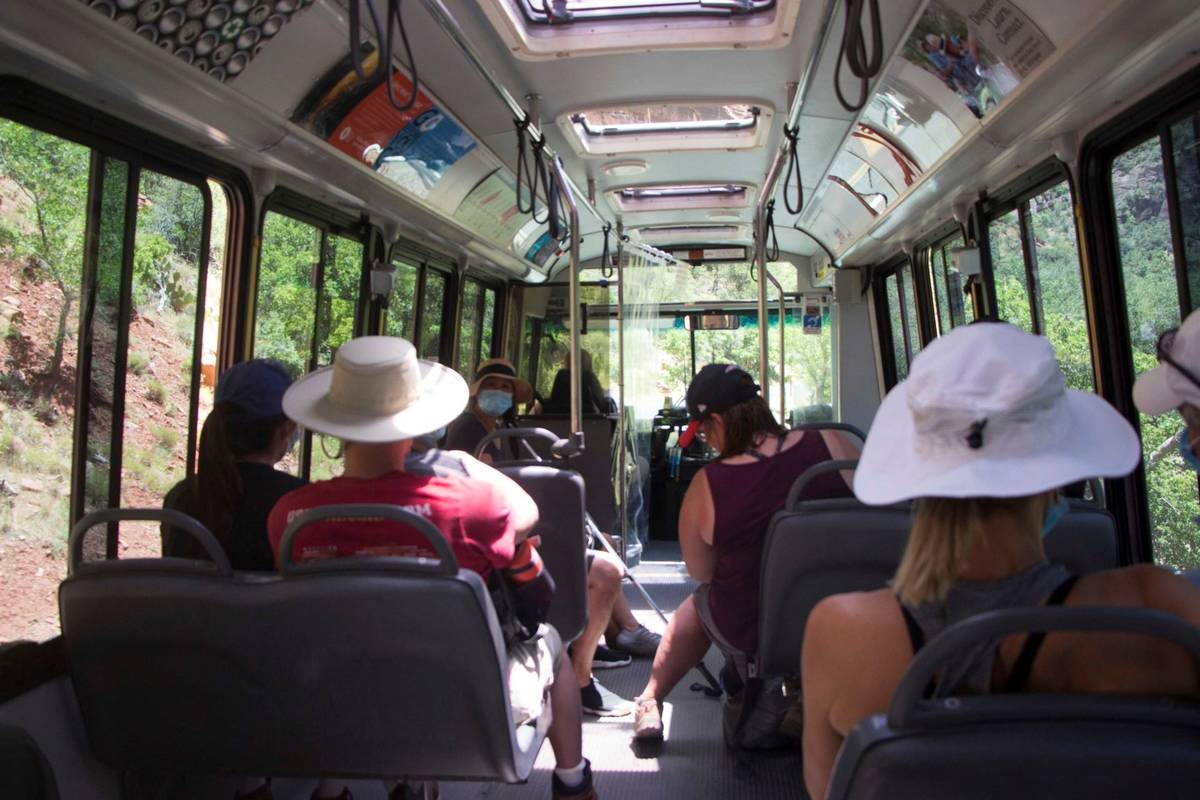 A visitors to Zion National Park, Utah ride a shuttle bus on Wednesday, July 1, 2020. (K. Sophi ...