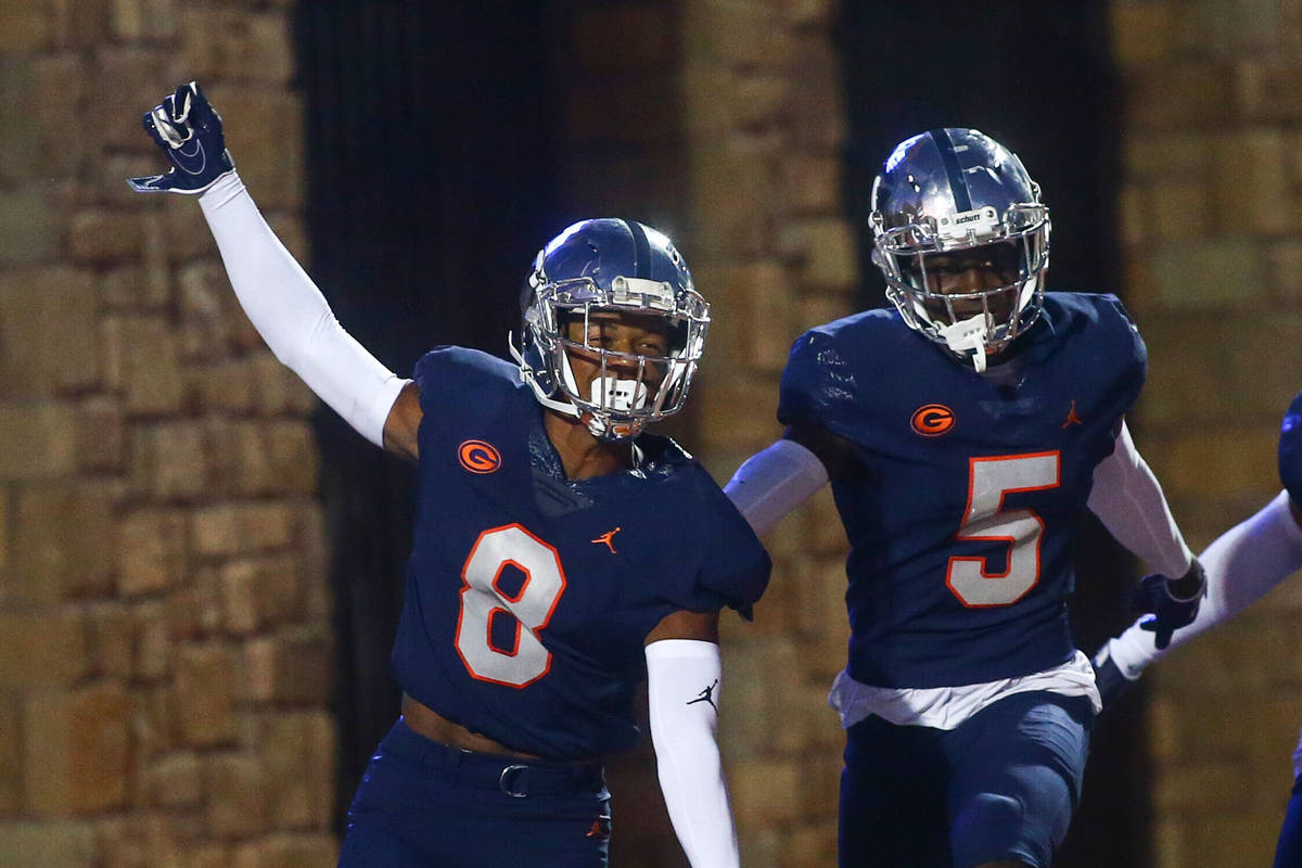 Bishop Gorman's Fabian Ross (8) celebrates his touchdown with teammates during the first half o ...