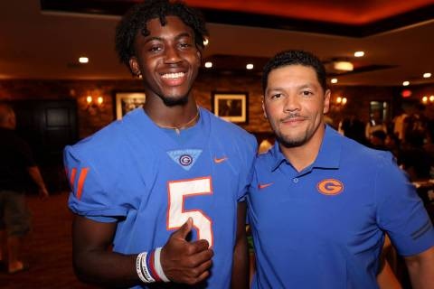 Bishop Gorman coach Brent Browner and safety Zion Branch, 5, pose during Southern Nevada Footba ...