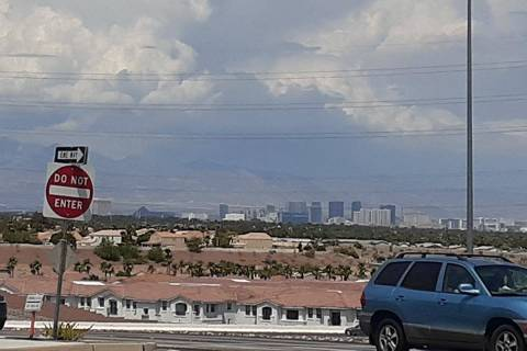Heavy clouds over the Spring Mountains as seen from Henderson on Saturday, July 31, 2021. (Marv ...