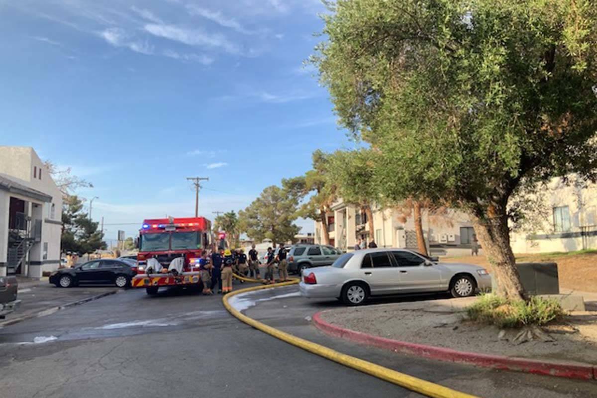 Crews battle a fire Saturday, July 31, 2021, at 1825 Lewis Ave. in Las Vegas. (Las Vegas Fire D ...