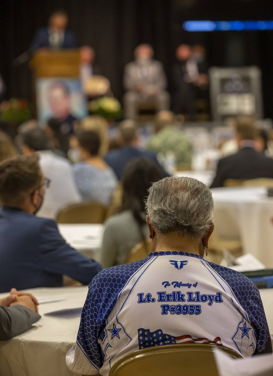 An attendee wears a memorial shirt during a public memorial service for former Metro Lt. Erik L ...