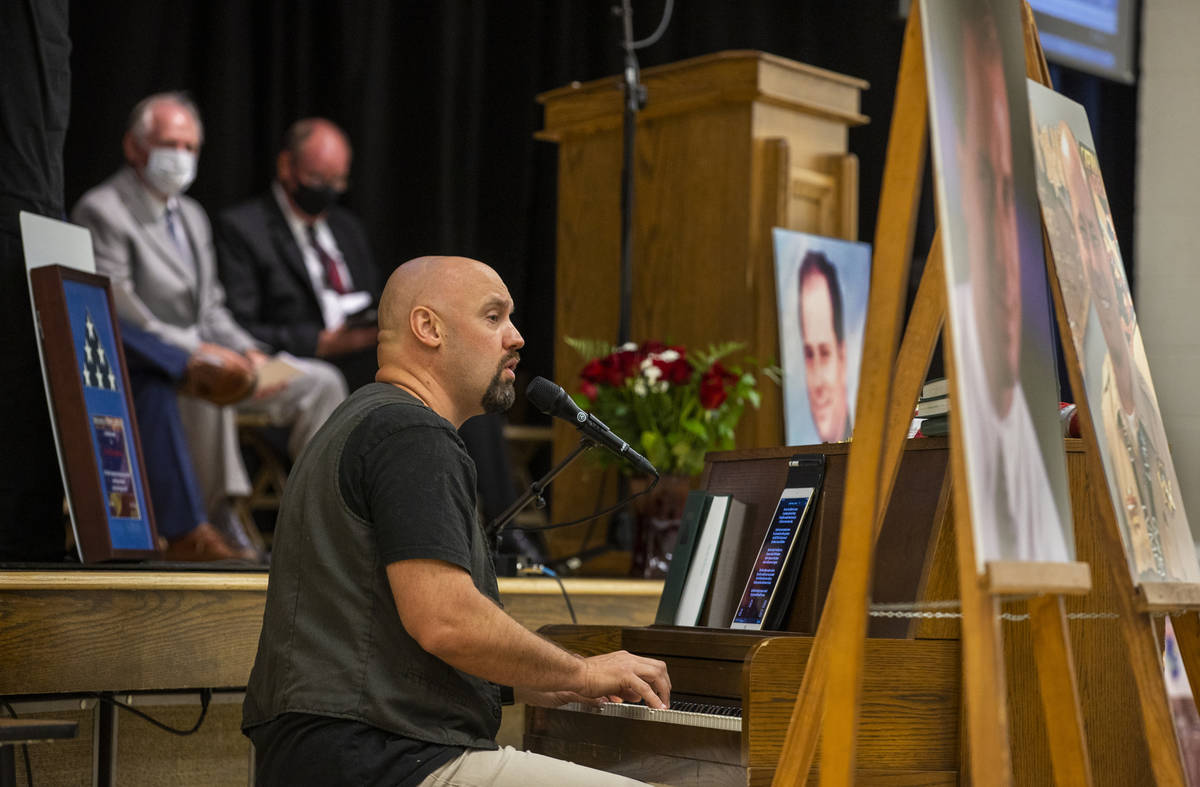 Performer Kyle Martin plays a Billy Joel song during a public memorial service for former Metro ...