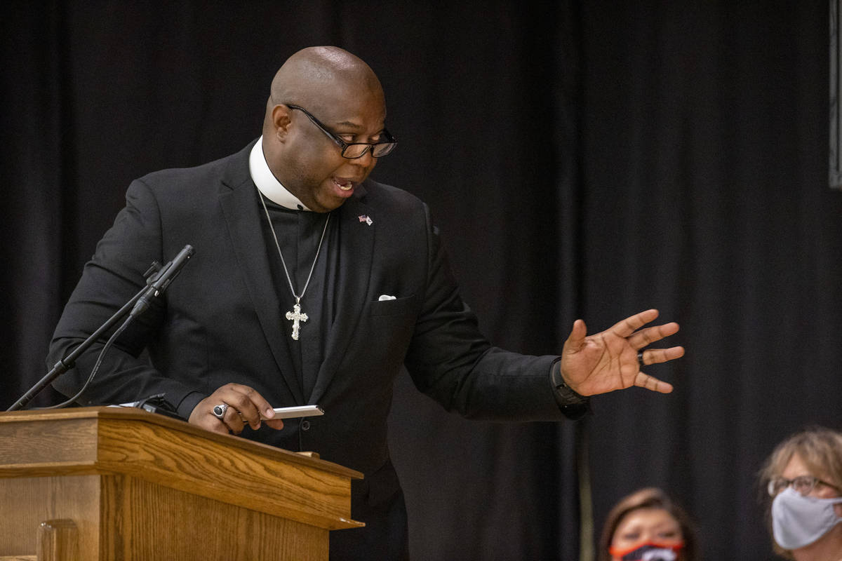 Pastor M.J. Ivy with the Kinship Community Church speaks during a public memorial service for f ...