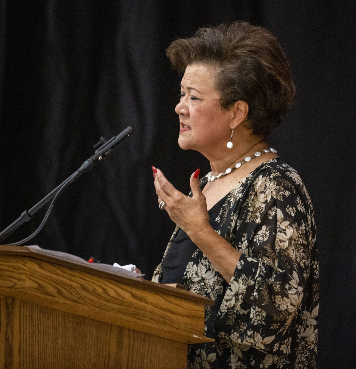 Gloria Caoile, president of the Asian Pacific American Labor Alliance, speaks during a public m ...