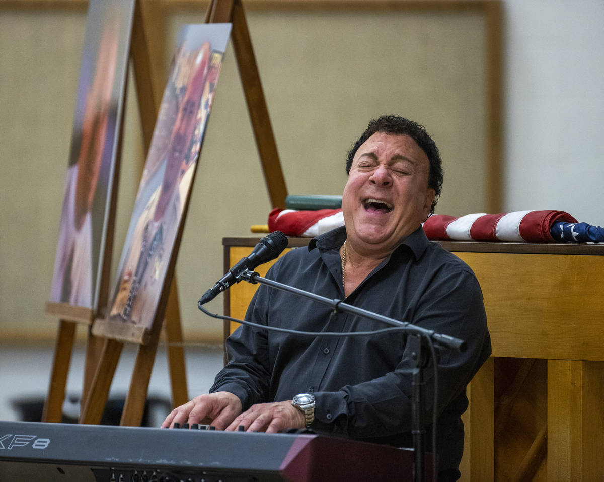 Performer Frankie Scinta sings a Beatles song during a public memorial service for former Metro ...