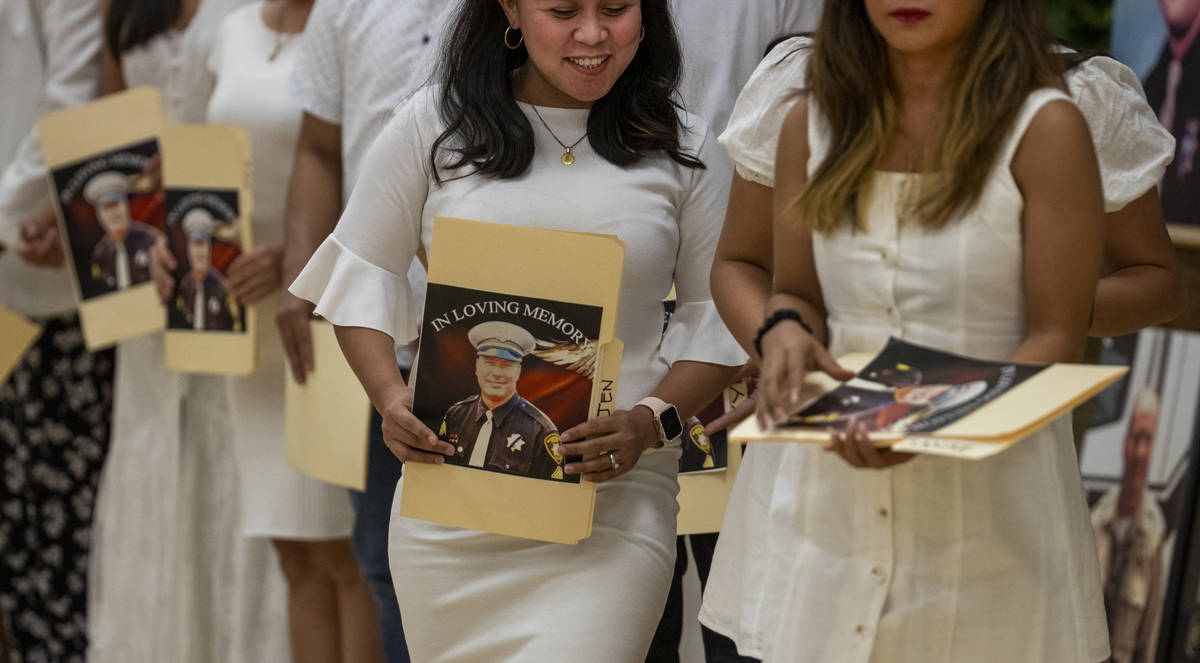 Members of the Filipino Teachers of Las Vegas walk off after singing a song during a public mem ...