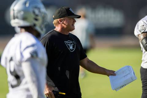 Raiders head coach Jon Gruden, middle, directs practice during training camp on Saturday, July ...