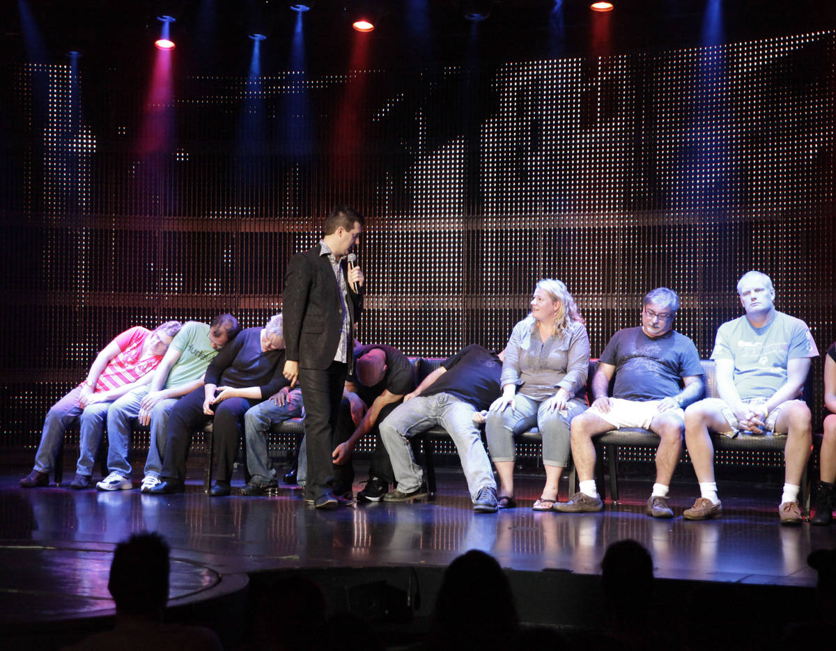 """Comic hypnotist Marc Savard talks with volunteer guests before he puts the to """"sleep&#x2 ..."""