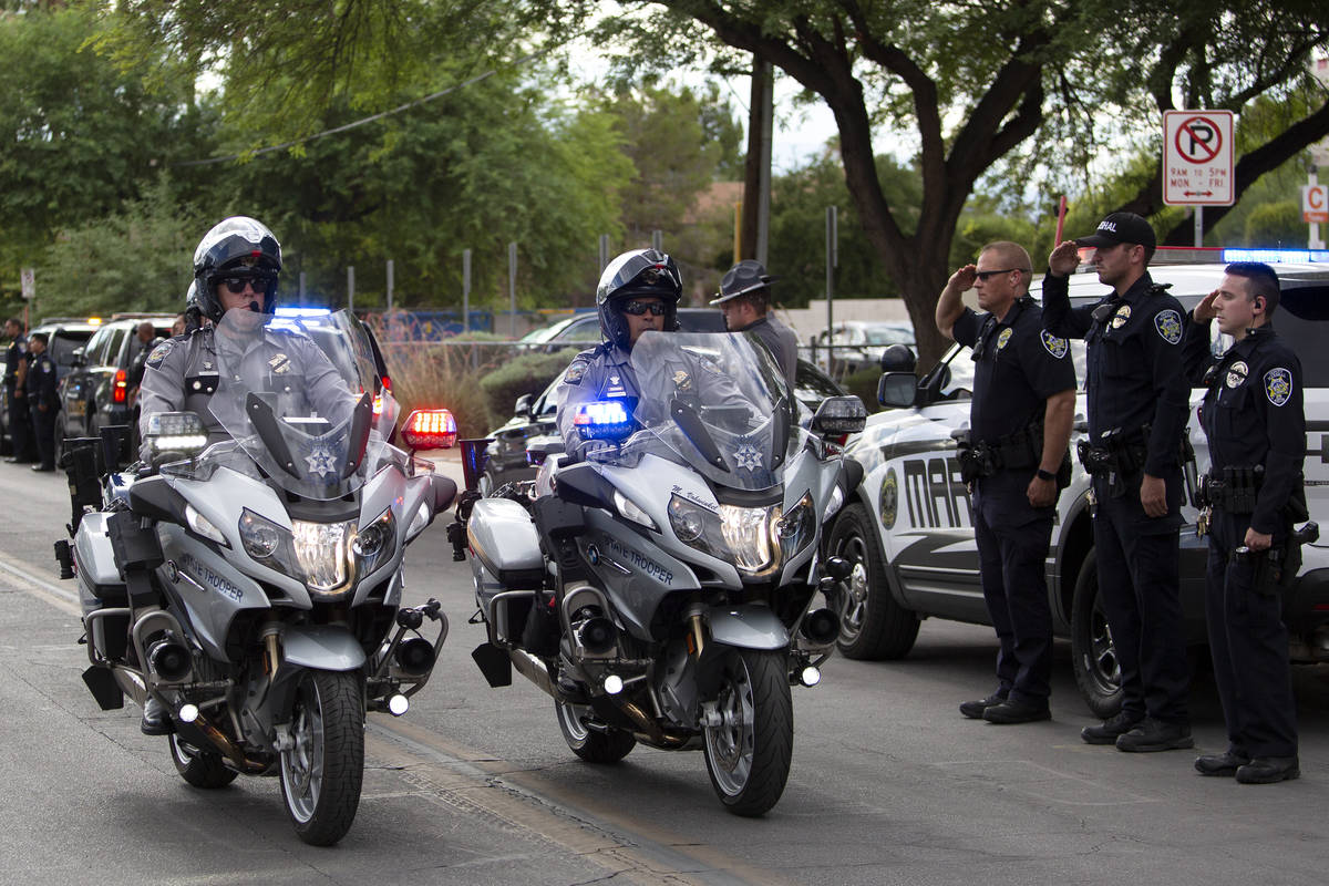 Law enforcement transports Nevada Highway Patrol trooper Micah May's body in a procession from ...