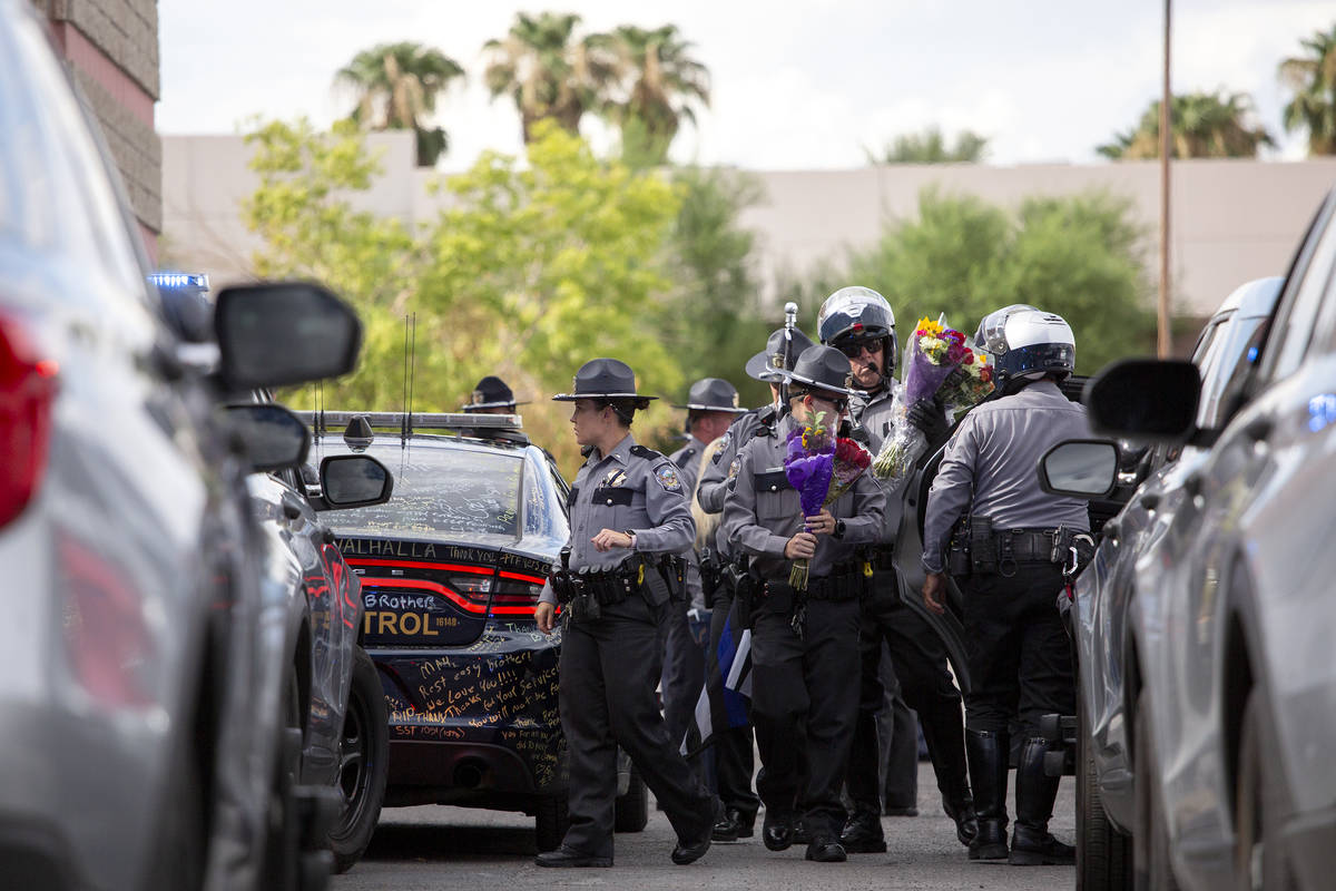 After a procession for Nevada Highway Patrol trooper Micah May's body from University Medical C ...