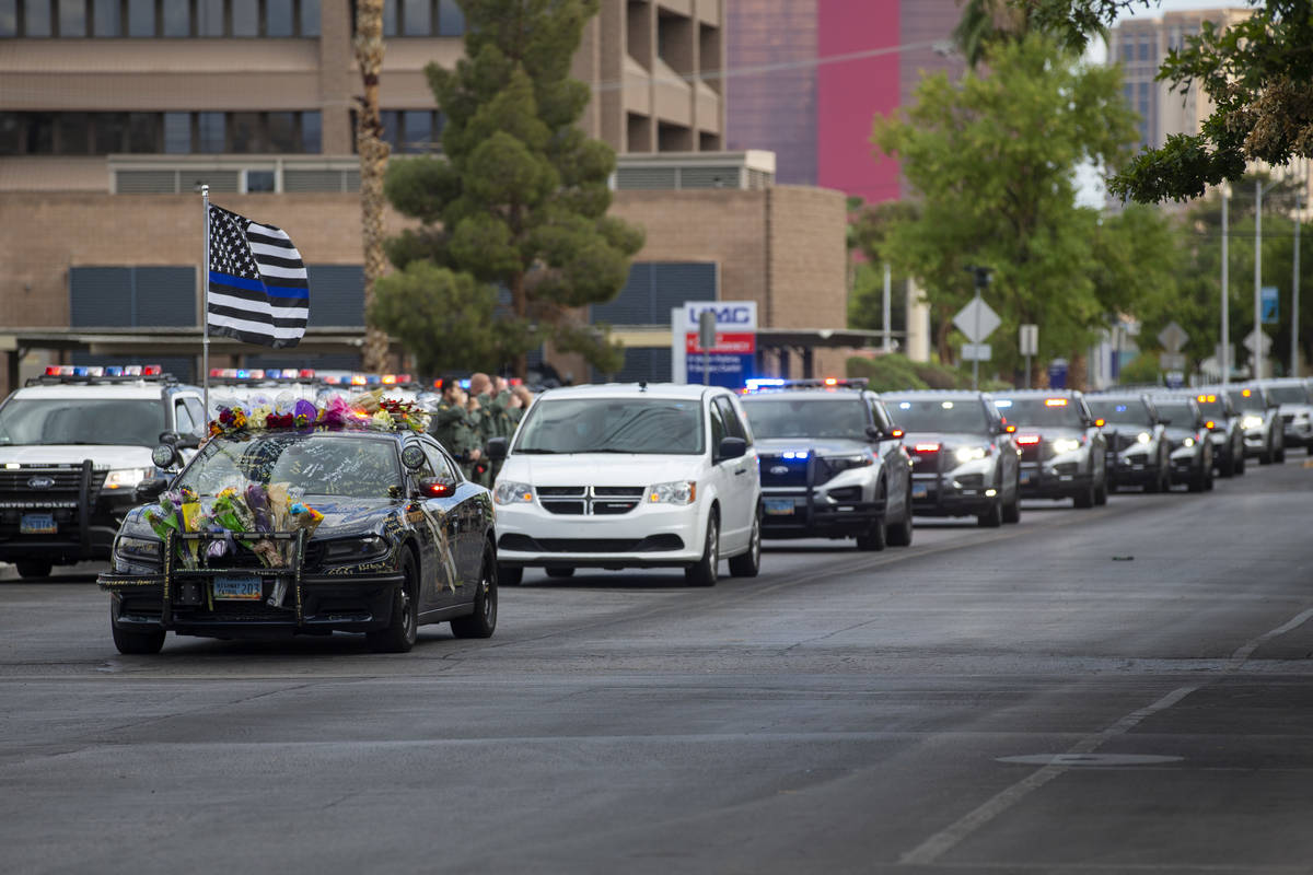 The body of a slain Nevada Highway Patrol Trooper Micah May is moved to the Clark County corone ...