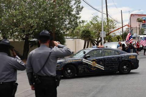 Nevada Highway Patrol troopers salute Nevada Highway Patrol Trooper Micah May's patrol car and ...