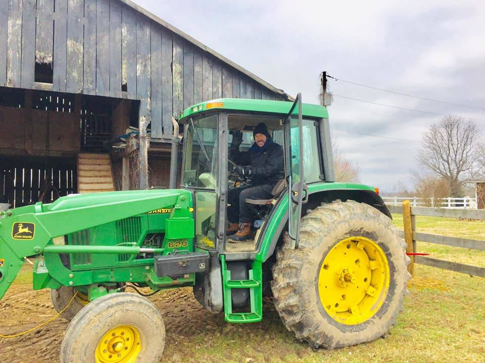 Lance Burton is shown on a John Deere 6120E compact tractor on his farm in Columbia, Kent., in ...