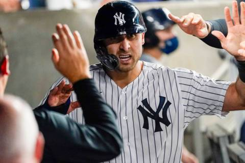 New York Yankees' Joey Gallo celebrates with teammates after scoring during the fourth inning o ...