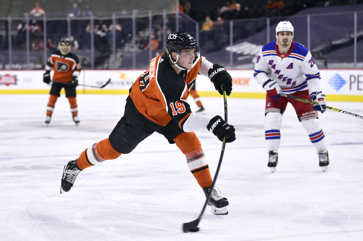 In this Saturday, March 27, 2021 file photo, Philadelphia Flyers' Nolan Patrick takes a shot on ...