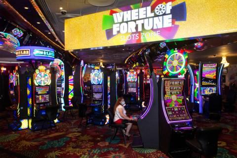 Perla Barragan of San Francisco, Calif., plays a slot machine in the Wheel of Fortune slots zon ...