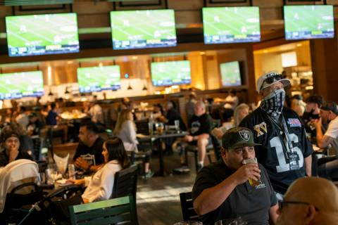 Football fans pack the Raiders Tavern and Grill for the NFL Draft at M Resort on Thursday, Apri ...