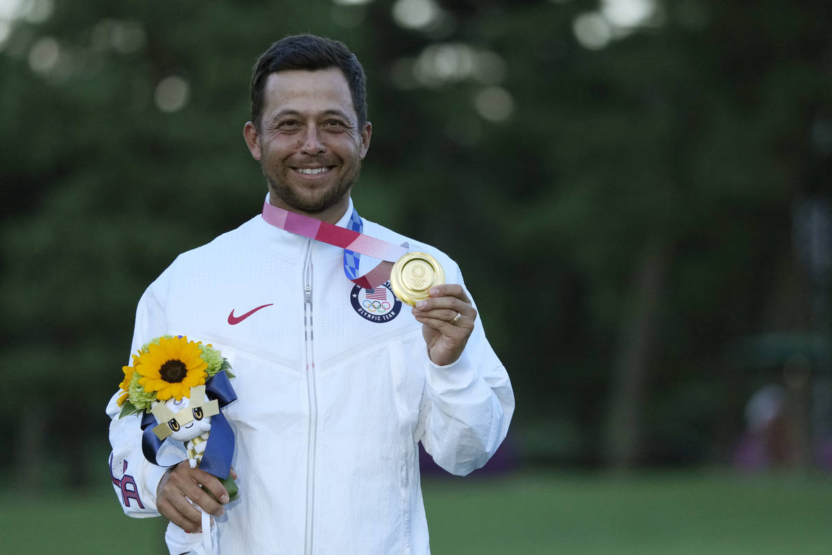 Xander Schauffele, of the United States, holds his gold medal in the men's golf at the 2020 Sum ...