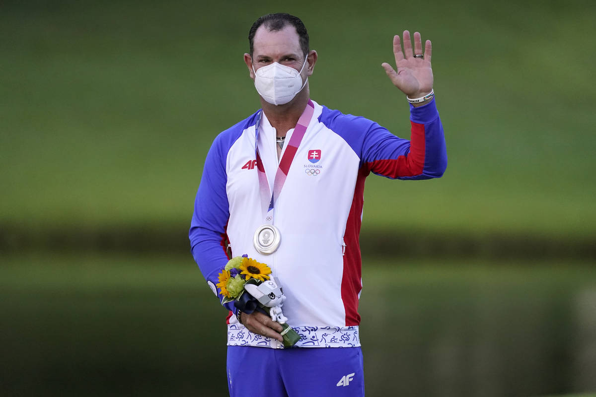 Silver medal winner Rory Sabbatini, of Slovakia, stands on the podium after the men's golf even ...
