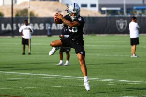 Raiders safety Tre'von Moehrig jumps to make a catch during an NFL football minicamp at Raiders ...