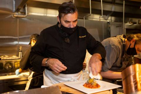 Chef and owner Todd English prepares a dish at Olives restaurant inside of Virgin Hotels Las Ve ...